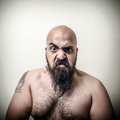 Super power angry muscle bearded man on gray background Royalty Free Stock Image