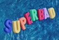 Superbad written on a blackboard writen with colored letters Stock Image