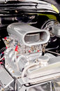 Supercharged engine chromed and supercharger on a high performance vehicle Royalty Free Stock Image