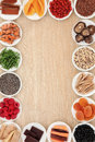 Superfood border healthy abstract over oak wood background Royalty Free Stock Image