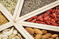 Superfood tray abstract dried goji berries golden flax pumpkin seeds almonds chia seeds and hemp seed hearts Stock Images