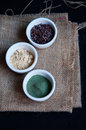 Superfood in white bowls maca spirulina and raw cacao nibs mini Stock Photography