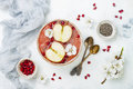 Superfoods smoothie bowl with chia seeds, pomegranate, sliced apples and honey. Overhead, flat lay. Rosh Hashana traditional food Royalty Free Stock Photo
