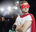 Superhero being photographed by paparazzi Stock Photos