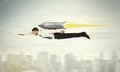 Superhero business man flying with jet pack rocket above the cit Royalty Free Stock Photo