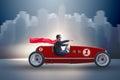The superhero businessman driving vintage roadster
