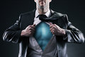 Superhero businessman pulls open shirt change and success concept Royalty Free Stock Photography