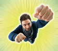 Superhero with fist thrust forward flying in the sky Stock Image