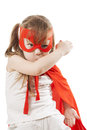 Superhero girl in a red little raincoat and mask Stock Images