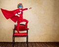 Superhero kid in Christmas Royalty Free Stock Photo