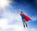 Superhero kid flying Stock Images