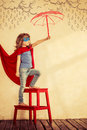 Superhero kid full length portrait of against grunge wall background Royalty Free Stock Photos