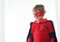 Superhero kid smiling super hero with red mask and cape close up Royalty Free Stock Photo