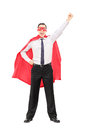 Superhero with raised fist full length portrait of a isolated on white background Royalty Free Stock Images