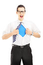 Superhero screaming and opening shirt blank blue t shirt undern underneath provides excellent copy space for your image text or Royalty Free Stock Photography