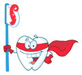 Superhero tooth with toothbrush Stock Photo