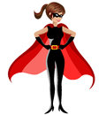 Superhero woman standing hands hips isolated