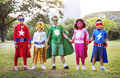 Superheroes kids friends playing togetherness fun concept Royalty Free Stock Images