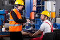 Superior and worker in warehouse elder female is instructing young male Royalty Free Stock Images