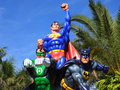 Superman green lantern and batman three fictional characters superheroes members of the justice league figures set against palm Royalty Free Stock Image
