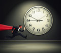 Superman running against big white clock