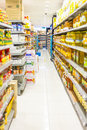 Supermarket aisle and shelves displaying variety of groceries product along the cooking oil department Royalty Free Stock Photography