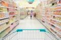 Supermarket aisle with shopping cart Royalty Free Stock Image