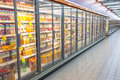 Supermarket aisle stretch of shelf fridge with glass door selling variety of juice and other beverage at the photo was taken on Stock Photo