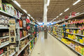 Supermarket aisle with variety of items for sale Royalty Free Stock Image