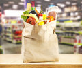 Supermarket brown table and on background blured and bag with products Royalty Free Stock Photography