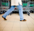 Supermarket buyer - Shopping carts Stock Images
