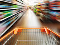Supermarket cart shopping running in the Royalty Free Stock Photo