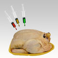 Supermarket chicken with additives - chemicals, hormones etc. Royalty Free Stock Photo