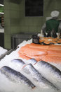In supermarket fresh raw red fish on ice the sturgeon pieces Stock Photo