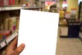 At the supermarket hand holding blank copy space a you can put a shopping list there or your own product Stock Images