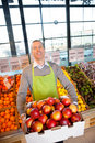 Supermarket Owner with Fresh Produce Stock Photos