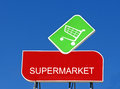 Supermarket sign with a shopping cart on top Royalty Free Stock Photo