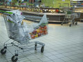 In supermarket trolley with pepper and other products indoors cucumber Stock Image