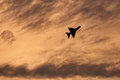Supersonic jet fight airplane flying during sunset