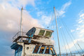 Superstructure of the old ship close up a and captain s cabin weathered on a blue sky background Stock Photo