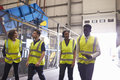 Supervisor and coworkers walking in an industrial interior Royalty Free Stock Photo
