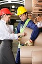 Supervisor and foreman checking cardboard at young with female warehouse Royalty Free Stock Photos