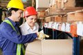 Supervisor and foreman checking stock at warehouse young female Stock Photo