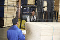 Supervisor By Laborer With Forklift Carrying Wood Royalty Free Stock Photo