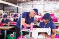 Supervisor taking score senior textile factory from machinist Royalty Free Stock Photos
