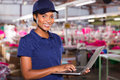 Supervisor using laptop happy african factory Stock Photo