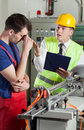 Supervisor yelling at worker in a factory Royalty Free Stock Photos