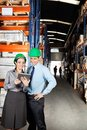 Supervisors using digital tablet at warehouse female supervisor and colleague Royalty Free Stock Photo