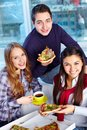 Supper image of teenage friends eating pizza together Royalty Free Stock Photography