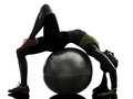Supple woman exercising fitness ball workout silhouette one on in on white background Royalty Free Stock Photos